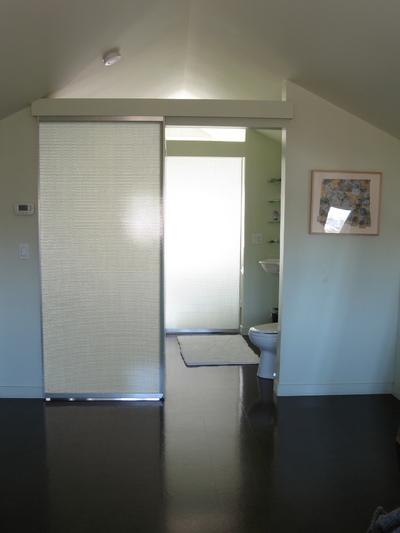 Schism Design - Doors open to powder room