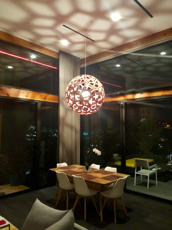 Schism Design - Dining with dramatic lighting