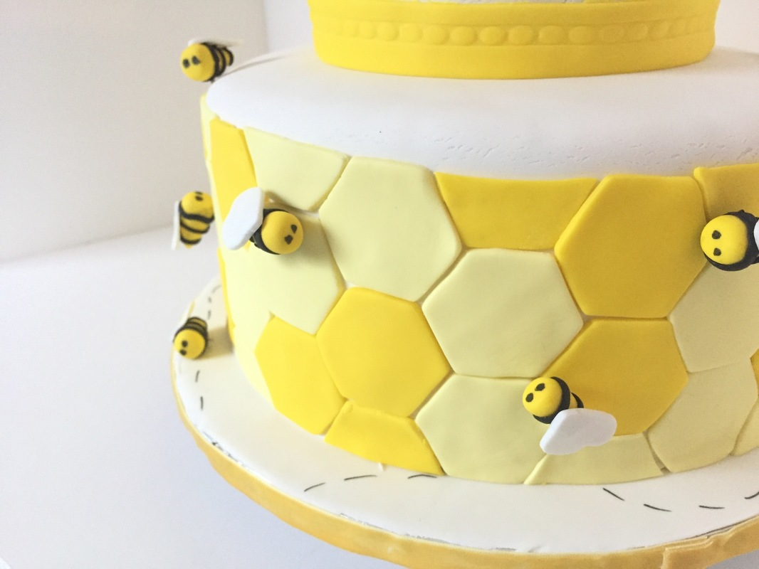 Simply Cakes - Honey bee baby shower cake with honeycomb detail and little bees buzzing!