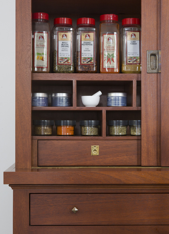 MKY Design - The tall apothecary cabinet houses spices and odds and ends.