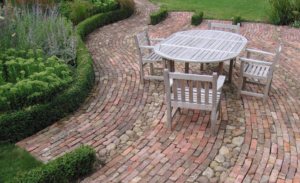 plants by design - terrace surfaced with reclaimed bricks