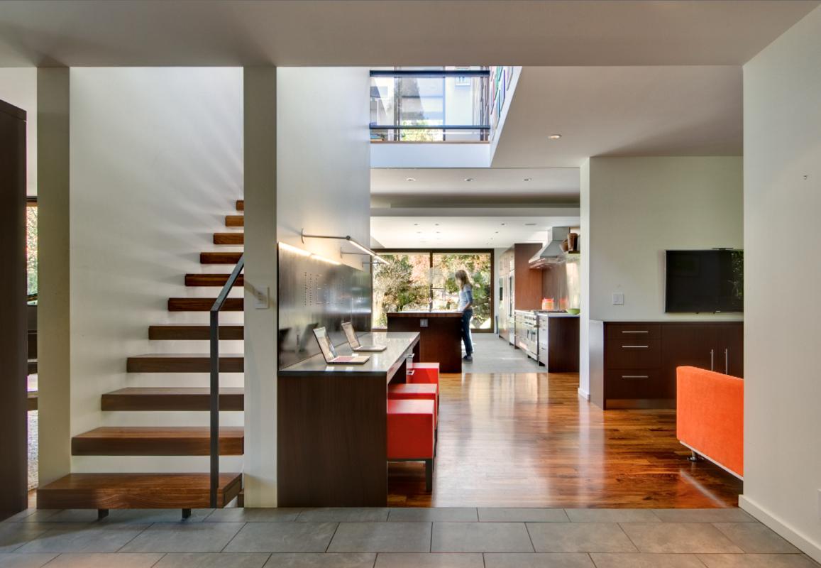 Holland Stephens Interiors - Floating Walnut steps and custom steel railing