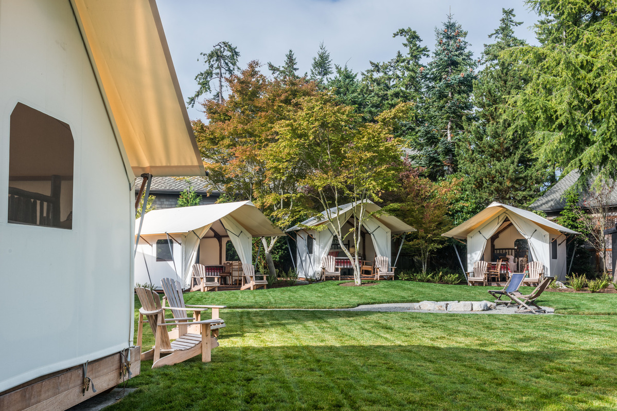 Holland Stephens Interiors - Three additional smaller guest tents arranged around a central fire ring.