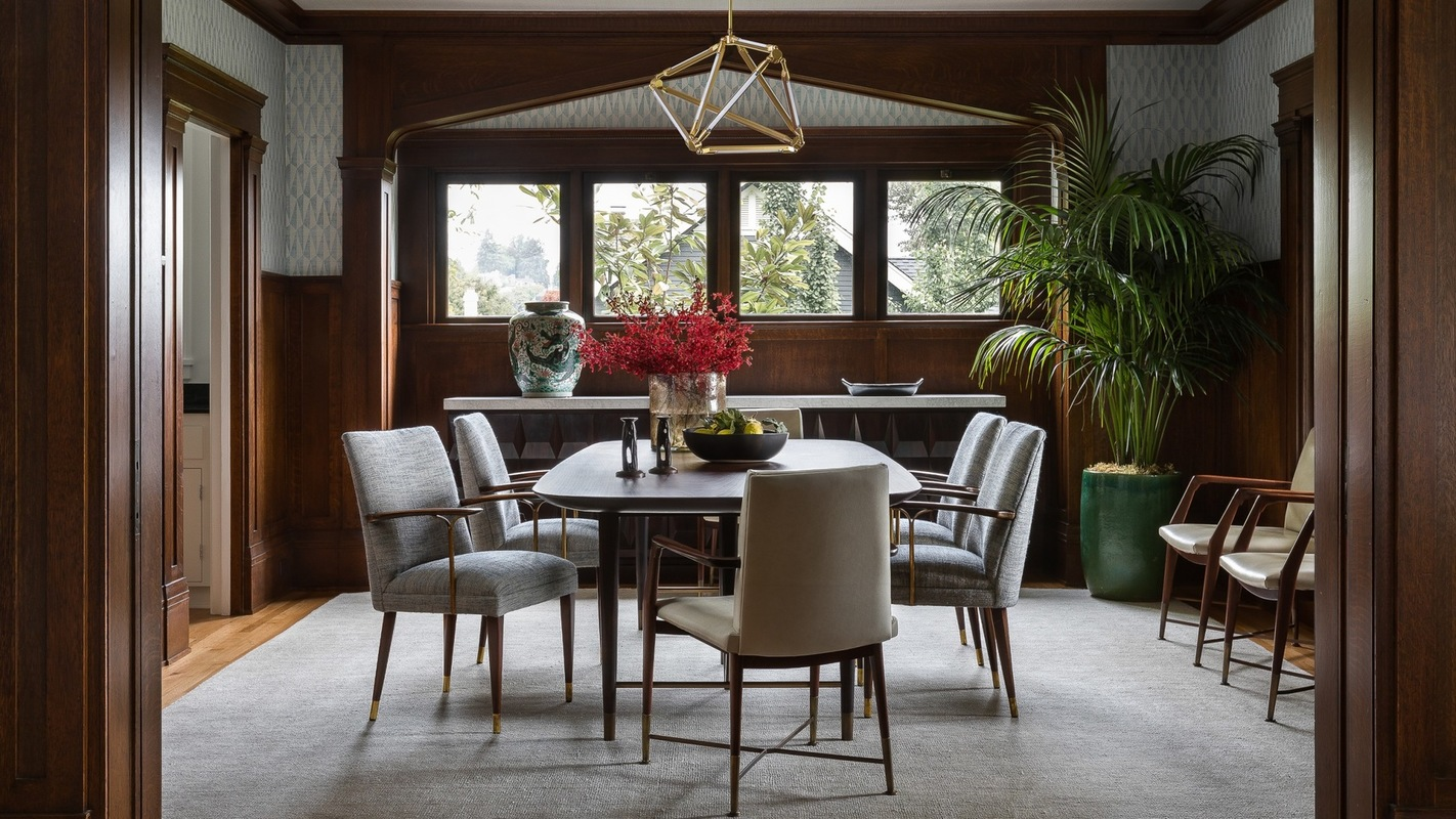 Holland Stephens Interiors - Dining room with custom table and vintage chairs and sideboard