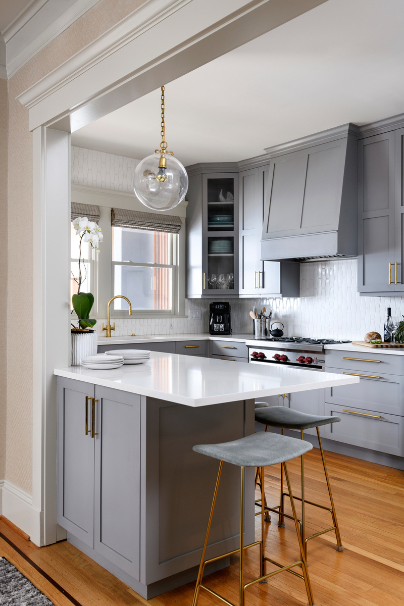 Holland Stephens Interiors - Kitchen dining area with new decorative lighting.