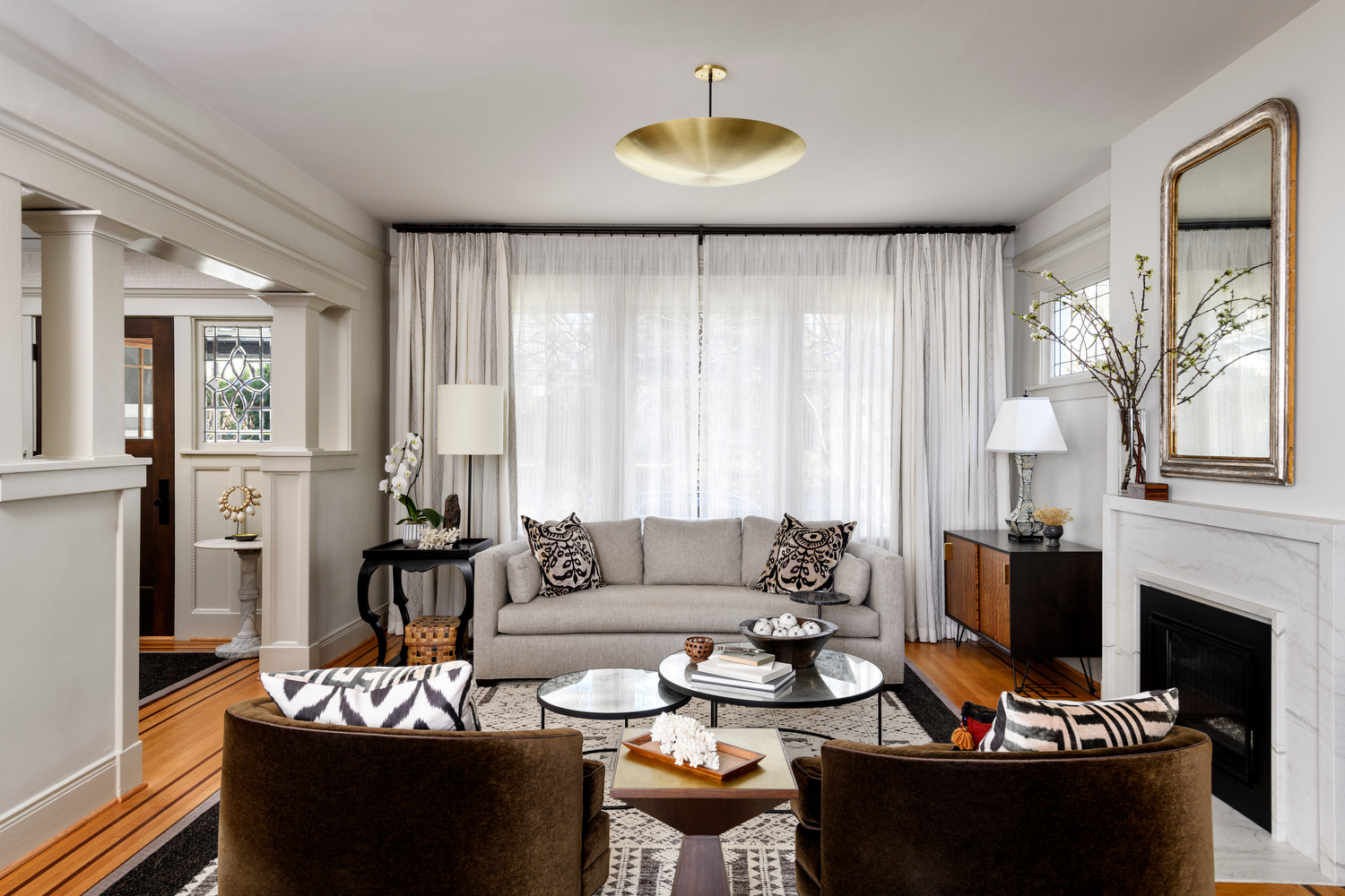 Holland Stephens Interiors - View east into the living room with custom made mohair swivel chairs.
