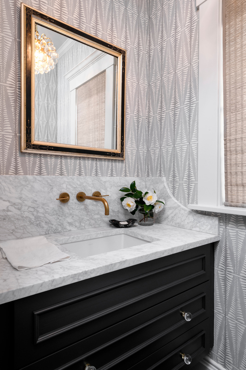 Holland Stephens Interiors - Powder room with vintage mirror and hand crafted wallpaper.
