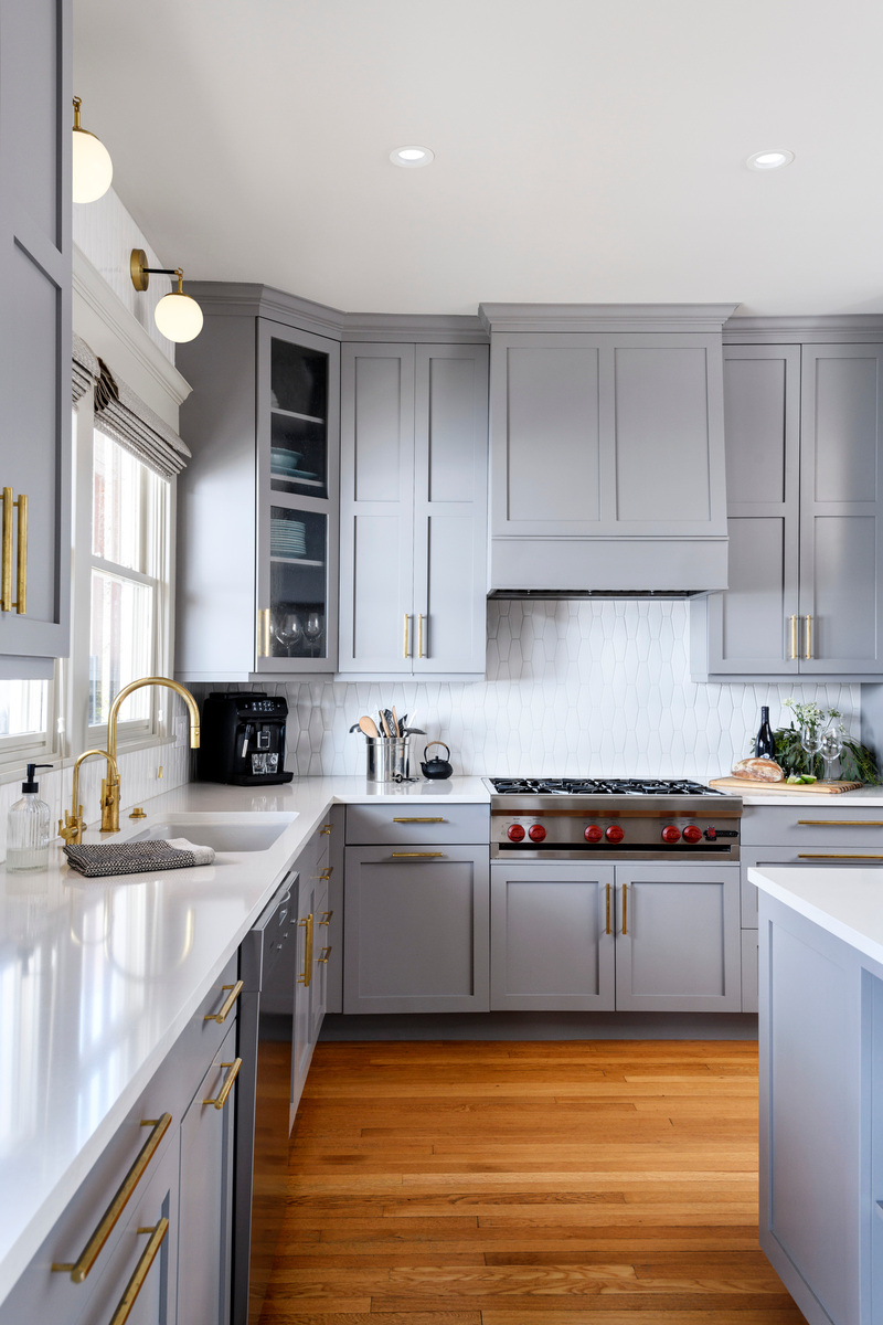 Holland Stephens Interiors - Refreshed kitchen with newly painted grey cabinetry and new natural brass pulls.