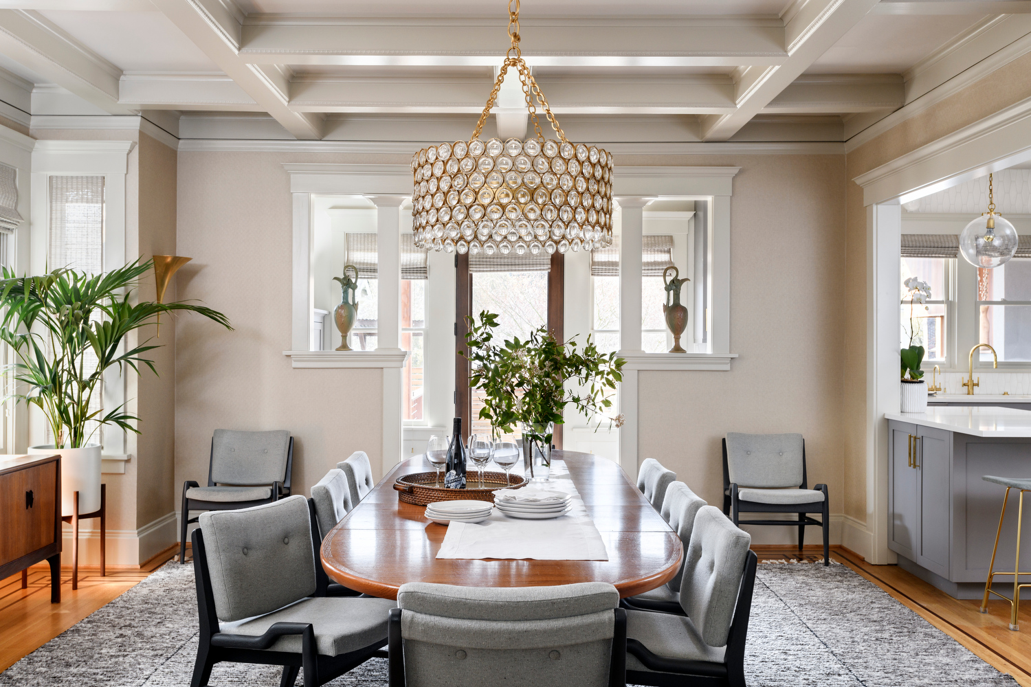 Holland Stephens Interiors - Dining room with new chandelier and mid century dining table and chairs with new upholstery.