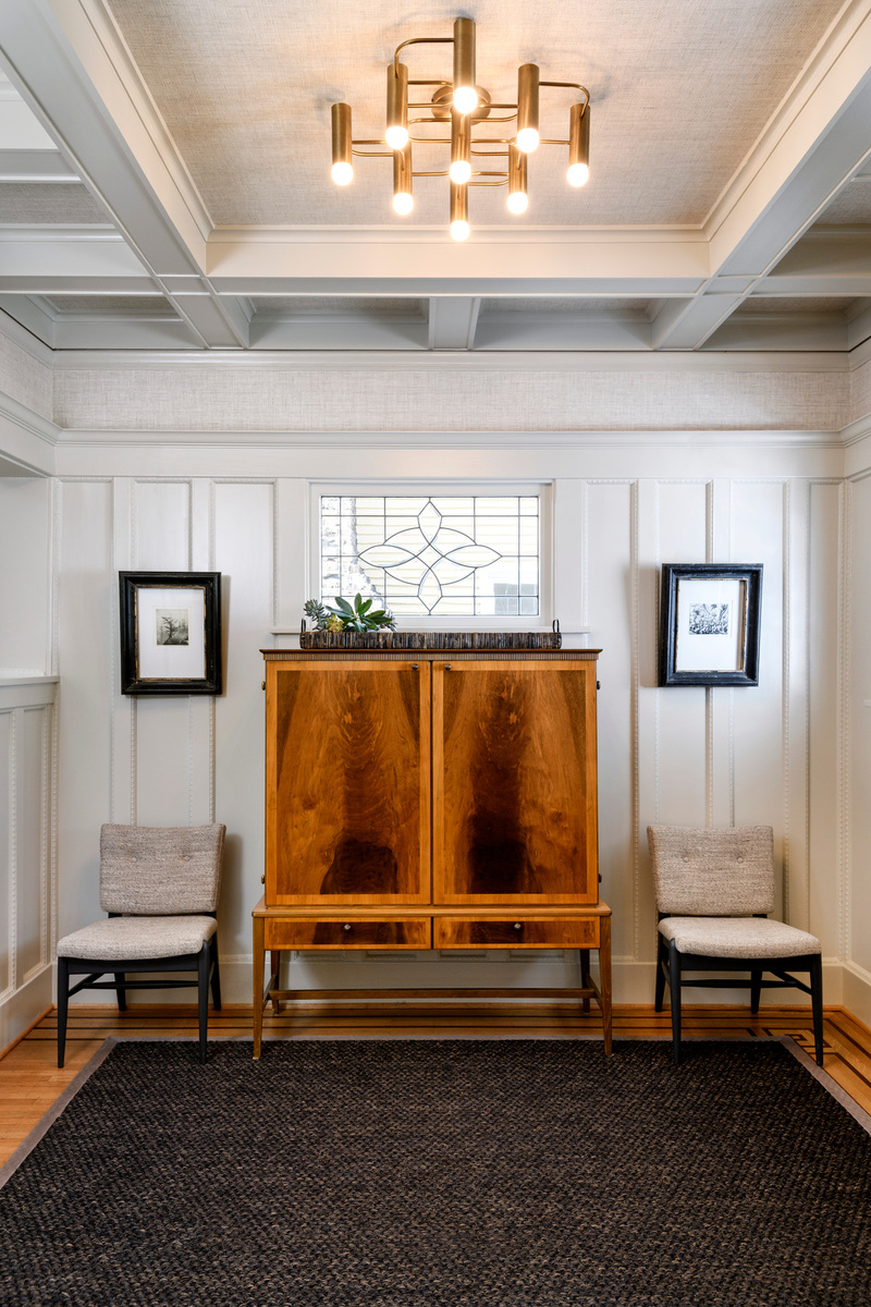 Holland Stephens Interiors - Front entry hall with vintage cabinet and vintage italian lighting.